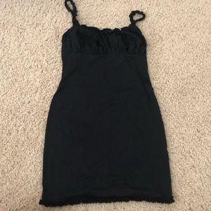 little black sundress with frilly detail